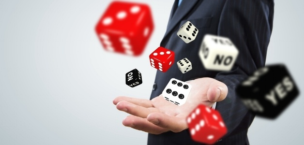 Close up of businessman throwing dice. Gambling concept-886975-edited.jpeg