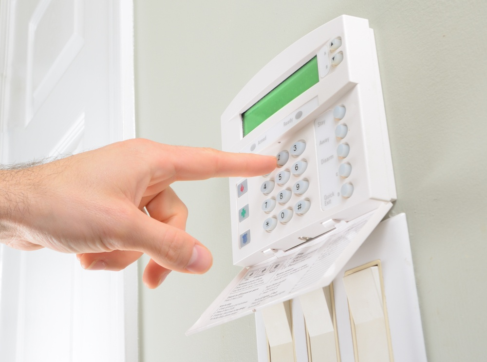 pressing the code on a house alarm.jpeg
